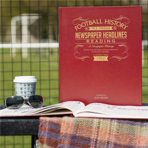 reading newspaper book red leather cover